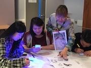 British Chinese artist Aowen Jin runs a UV light workshop in Birmingham\s Weekender Festival